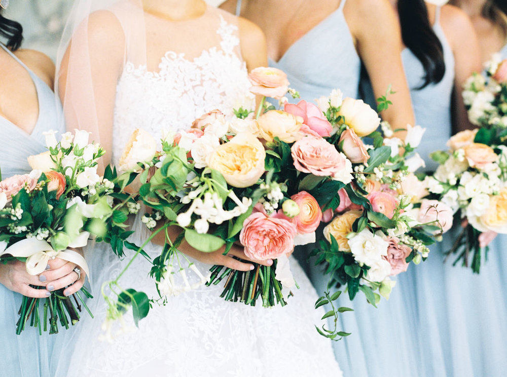 Bridal bouquet and bridesmaids bouquets created by fine art florist Maria Maxit, of Maxit Flower Design captured by fine art photographer Paige of Awake Photography at The Houston Country Club.