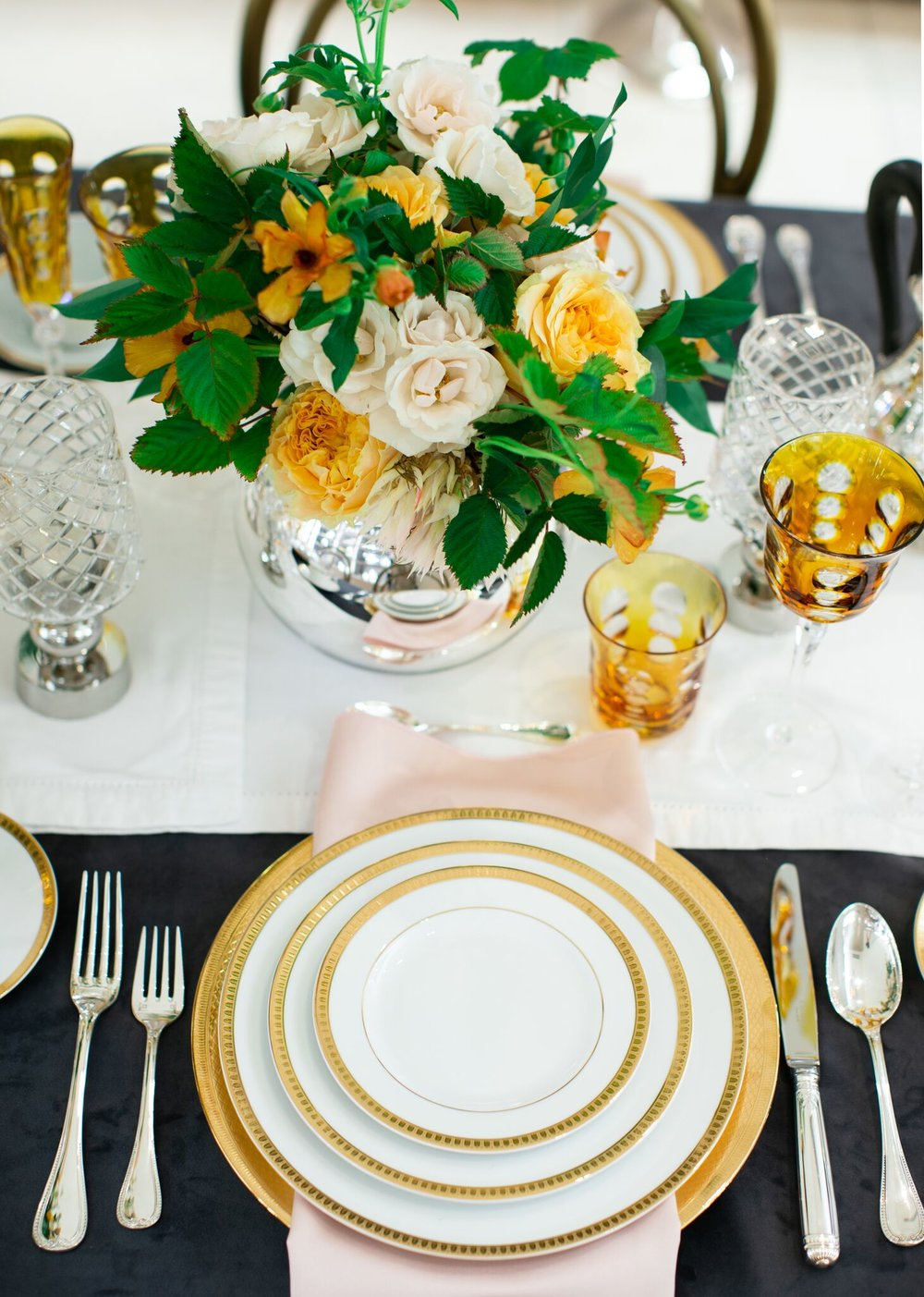 Gold place setting with yellow and ivory flowers.  Maxit Flower Design for Christofle in collaboration with Marie Flanigan Interior