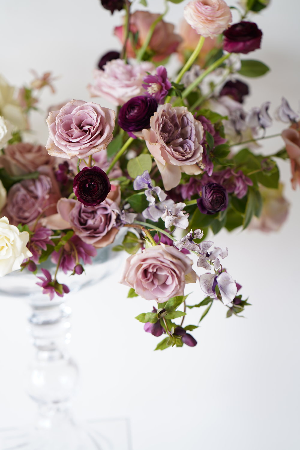 Detail shot of flowers. Hellebores, garden roses, sweet pea, and ranunculus. Maxit Flower Design