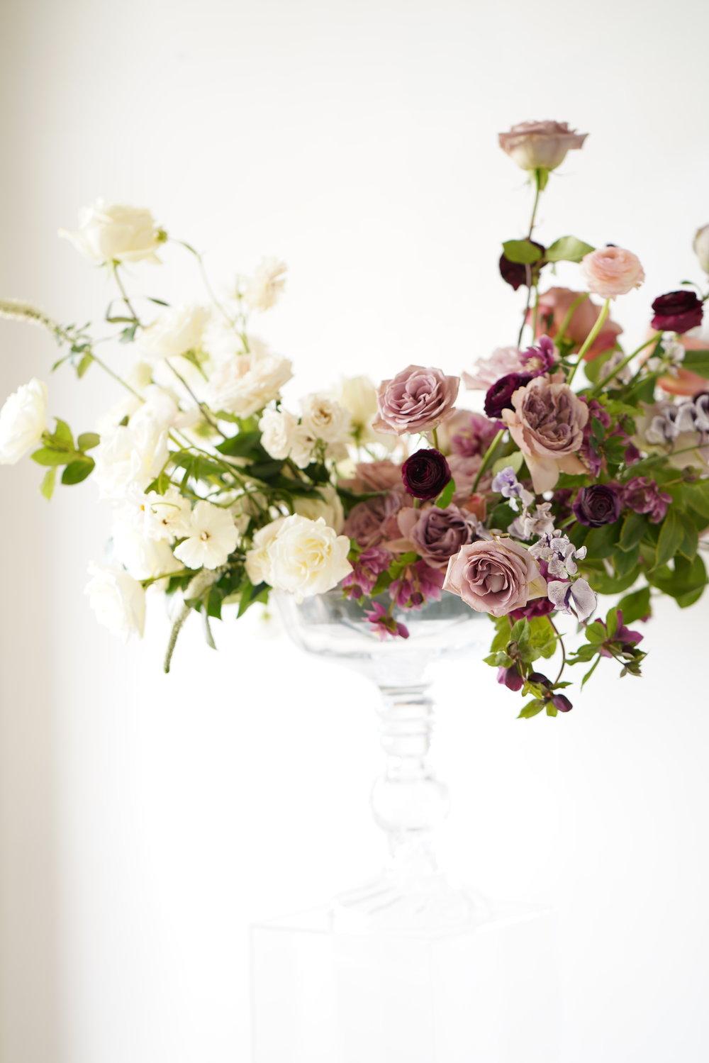 Garden style, tall arrangement created for a centerpiece at a wedding. Maxit Flower Design