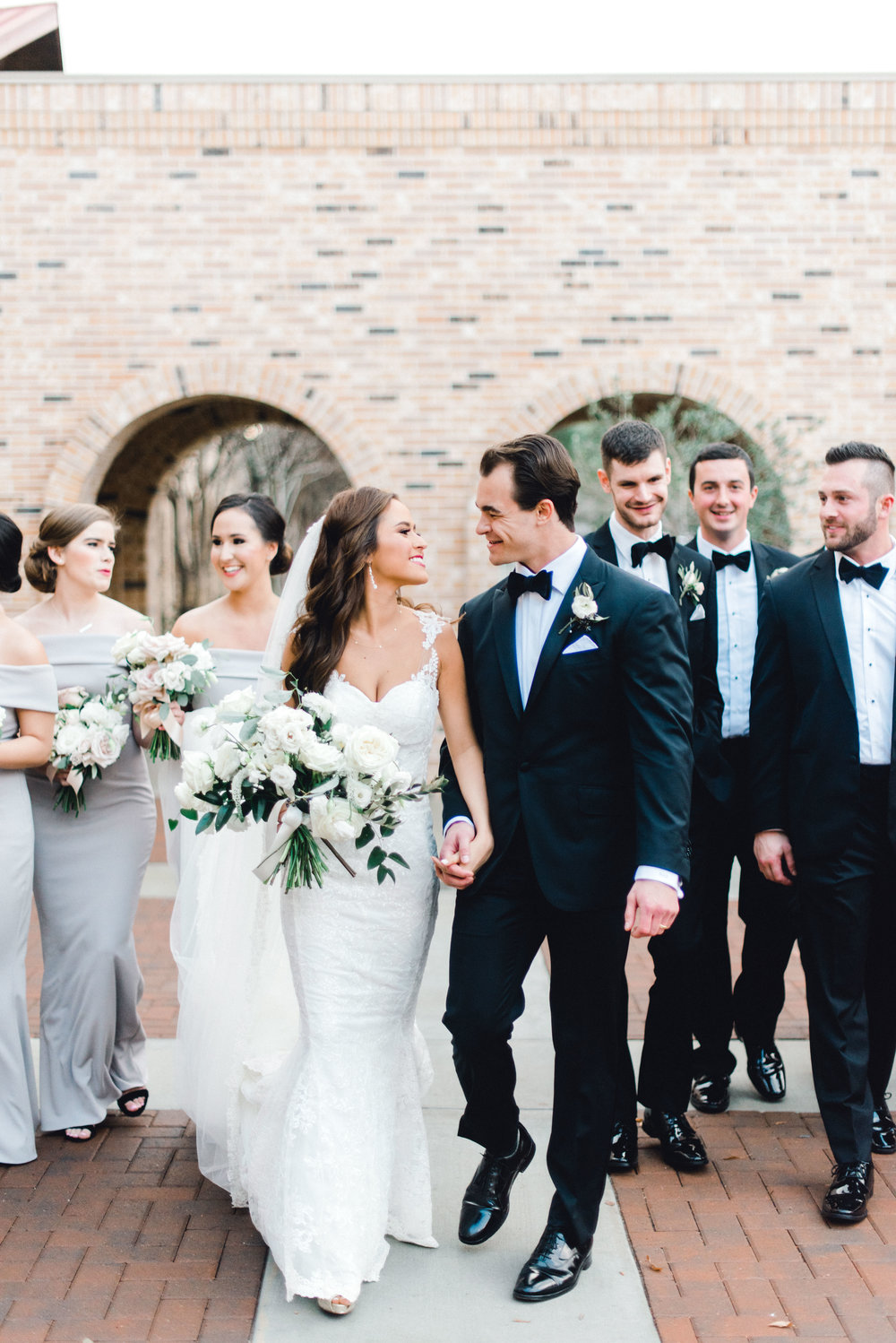 Bride and groom, photographed in Rice University by Josh and Dana Fernandez Photography. Flowers by Maxit Flower Design