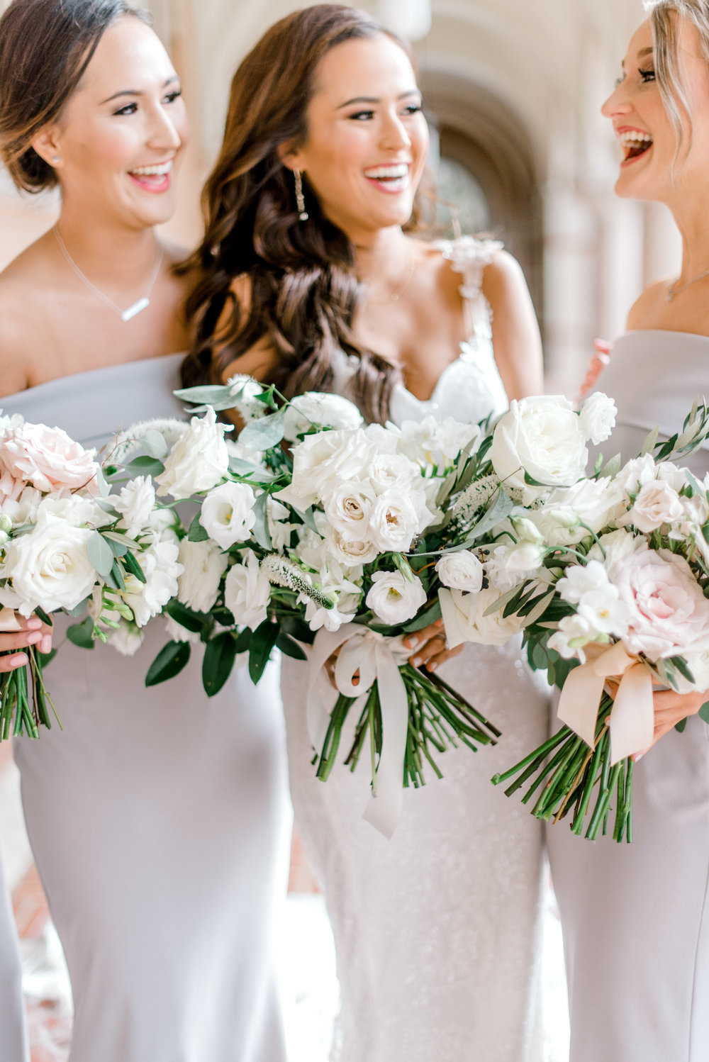 Bride and bridesmaids bouquets. Shot by Josh and Dana Fernandez in Rive University.