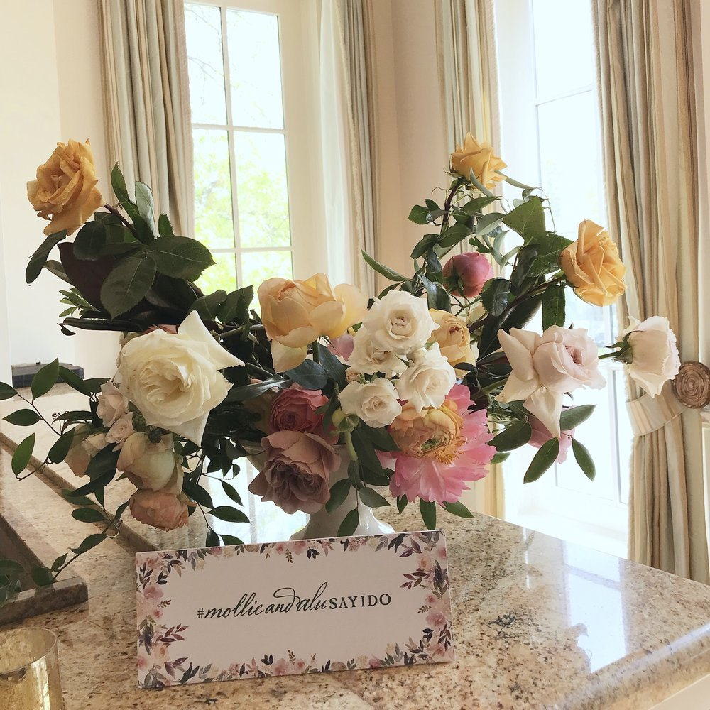 Garden compote with coral charm peonies, garden roses, roses, ranunculus, spirea, black berries and smilax. Keely Thorne Event Planning, River Oaks Country Club, Maxit Flower Design