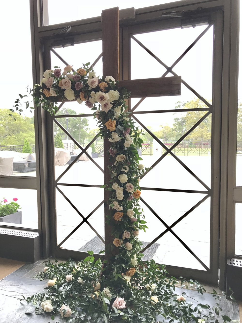 Cross alter with coral charm peonies, garden roses, roses, ranunculus, spirea, black berries and smilax. Keely Thorne Event Planning, River Oaks Country Club, Maxit Flower Design