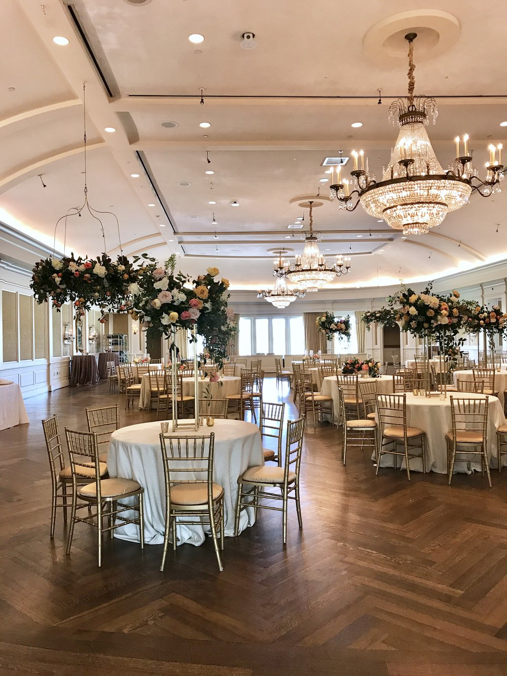 Room shot of Mollie & Alejandro's wedding.  We combined tall arrangements, low garden style compotes, with hanging floral chandeliers.   Keely Thorne Event Planning, River Oaks Country Club, Maxit Flower Design
