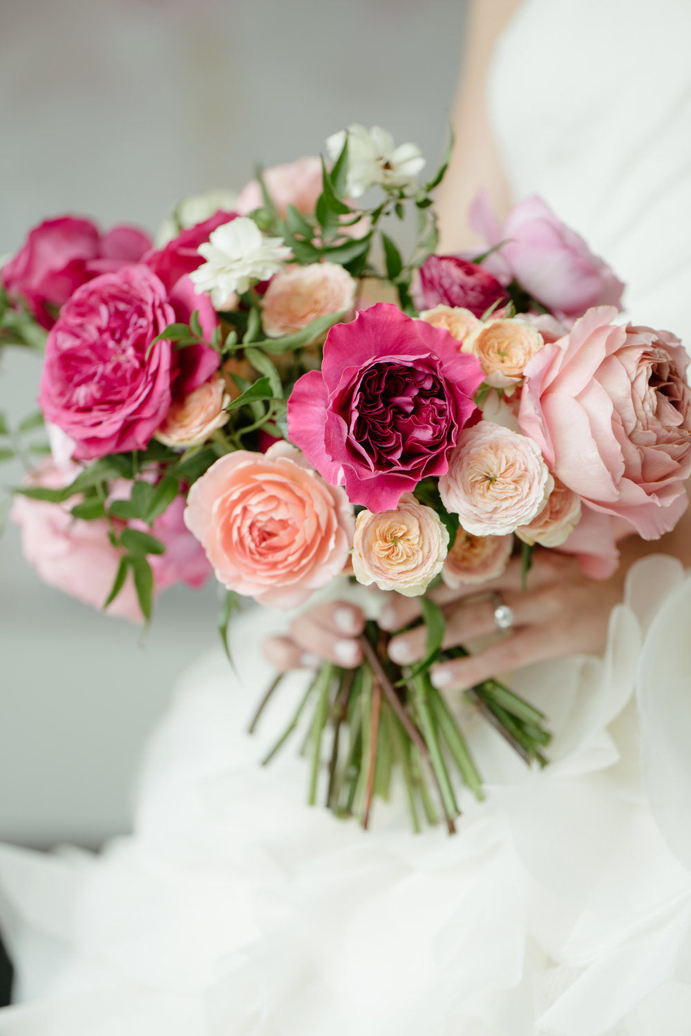Garden style bridal bouquet with coral, pink, blush and white garden roses. Maxit Flower Design's work captured by Adam Nyholt