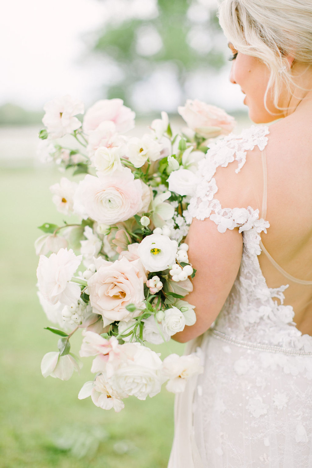 Bridal bouquet with blush and white flowers in a garden style by Maxit Flower Design. Photographed by Kate Elizabeth. Styled by Shannon Ducker