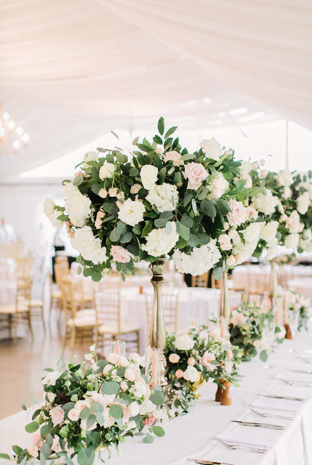 Garden style arrangement with high and low impact on head table at Houston Oaks Country Club
