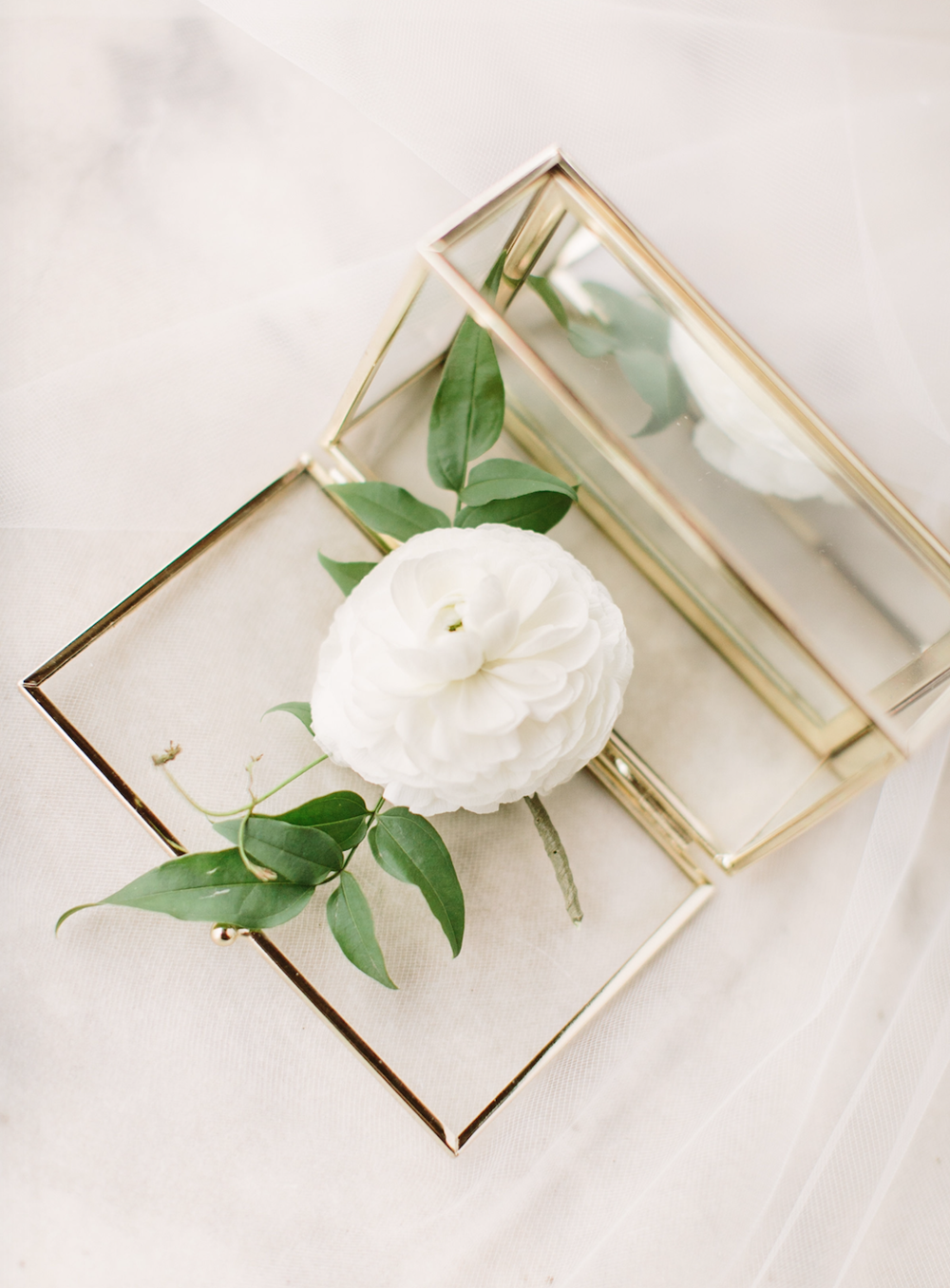 Gorgeous detail shot of groom's boutonniere. Made with ranunculus and a touch of jasmine.
