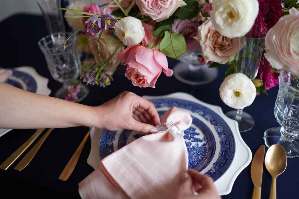Blush napkin on blue and white chinoiserie china. Something about pink and navy is so southern. Flowers and styling by Maxit Flower Design