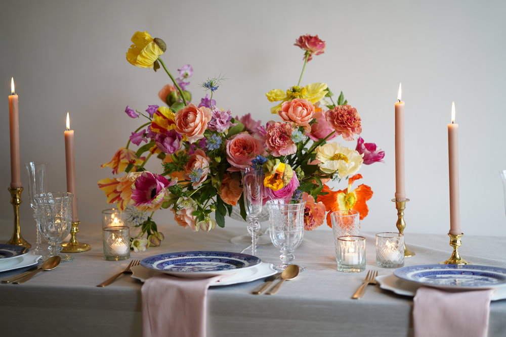 Stunning Southern spring tablescape with blush taper candles and blue and white chinoiserie china. Flowers and styling by Maxit Flower Design