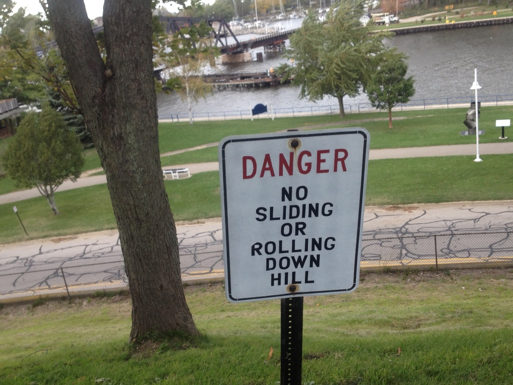 No rolling down hill & nothing about rolling one on hill : )