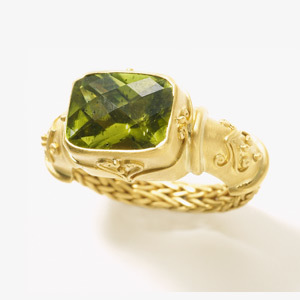 Ayu's Ring Delicate floral motifs grace this Balinese inspired design. Set with a Peridot. - $Call for price