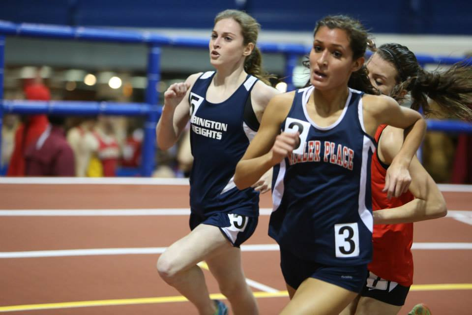 Tessa Barrett, left, powers home at the 2014 NYRR Millrose Games Trials.