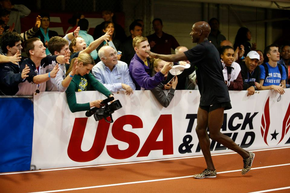 Bernard Lagat celebrates with fans at the 2013 NYRR Millrose Games. Photo/Ross Dettman