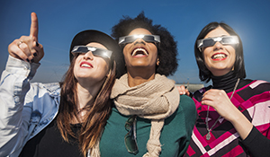 3-Women-Watching-Total-Solar-Eclipse-photo-Columbia-SC-iStock-LeoPatrizi.jpg