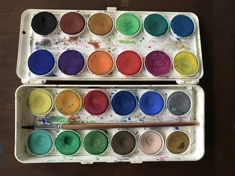 This is my dry pan, and I have two of these. My grandmother bought them for me. This is my opaque palette; the transparent one faded into the folds of the universe. I like the dry pans so much. It's all a lot less work. But all the good painters use wet tubes. So you can be like me and have both!