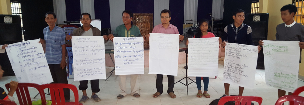 Results -- Seminar participants hold up panels with detailed plans for church planting.
