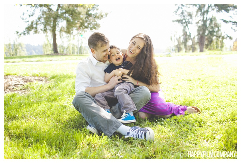 cuddling family photo  - the Happy Film Company - Mercer Island Family Photos