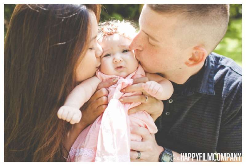 parents kissing baby's cheeks  -  the Happy Film Company - Seattle Family Photography