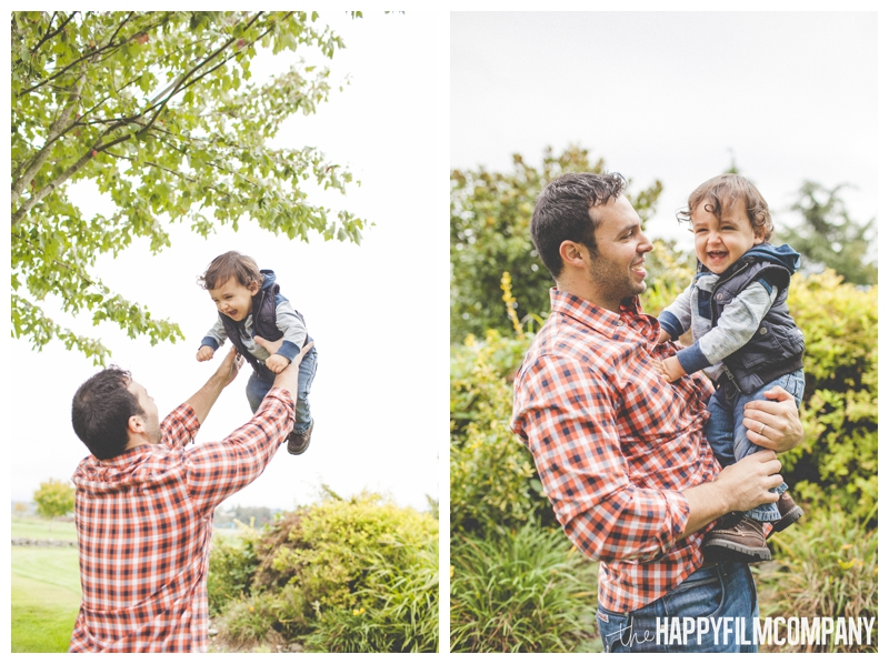 dad throwing son in air  - the Happy Film Company - Seattle Family Holiday Photos