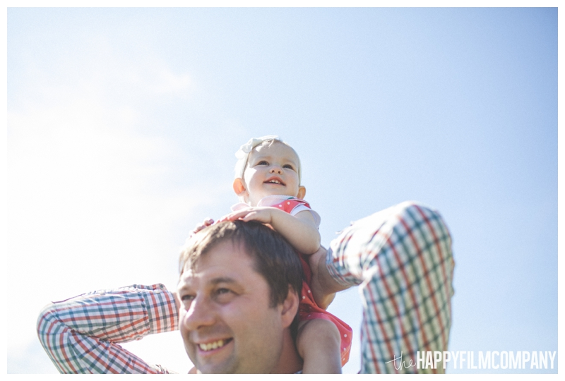 baby on dad's shoulders  - Seattle Family photo shoot - the happy film company