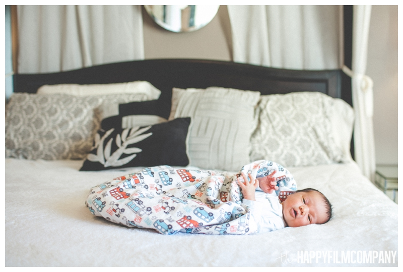 newborn baby on bed  - Natural Seattle Newborn Photography - the Happy Film Company