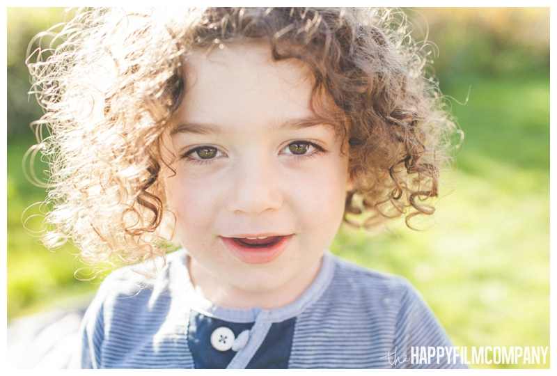 little boy with curly hair - Seattle Family Apple Picking Photo Shoot - the Happy Film Company