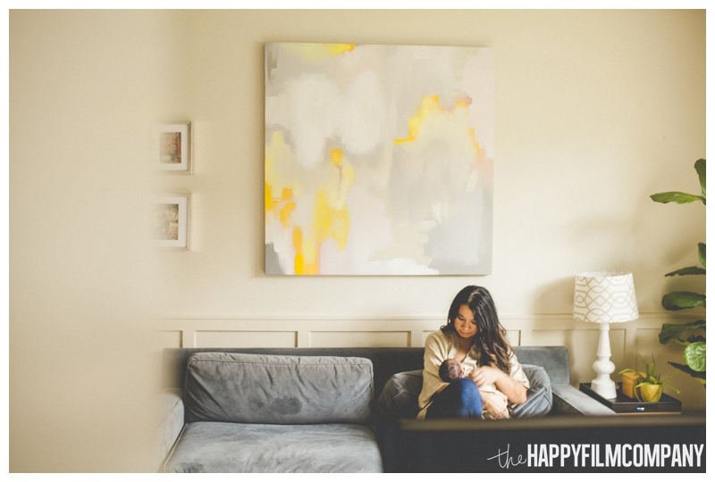mom sitting on couch with baby lifestyle photography  - the Happy Film Company - Seattle Newborn Photos at Home