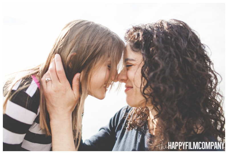 cute mother daughter portrait  – Playful Golden Gardens Beach Walk — Seattle Family Holiday Pictures