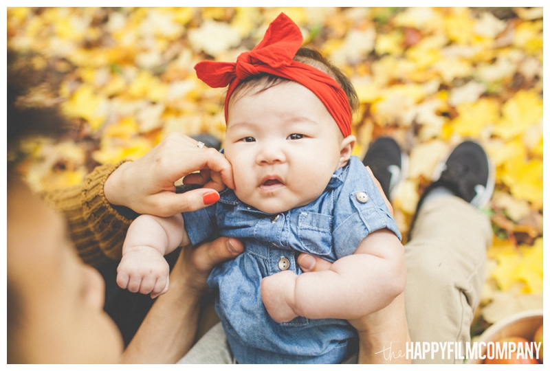 baby sitting on lap   - Seattle Family Holiday Portraits - the Happy Film Company