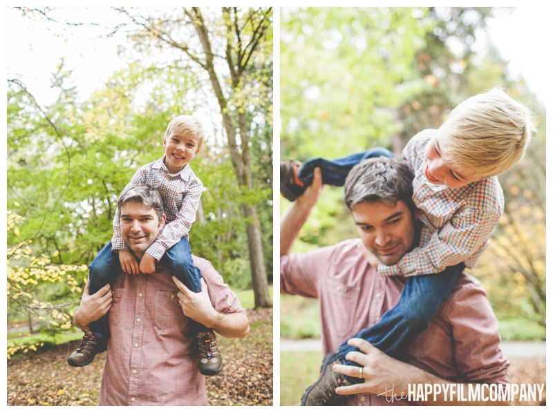son sitting on father's shoulders playful  - the Happy Film Company - Seattle family holiday photo shoots - Arboretum