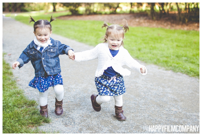 little girls holding hands and running - the Happy Film Company - Seattle Family Photography - Arboretum