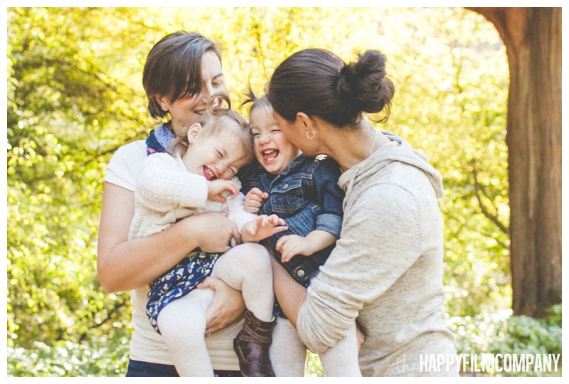 moms kissing kids on the check happy - the Happy Film Company - Seattle Family Photography - Arboretum