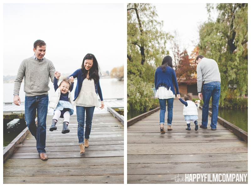 family walking on dock swinging kids  - the Happy Film COmpany - Greenlake Park Seattle Family HOliday Photos