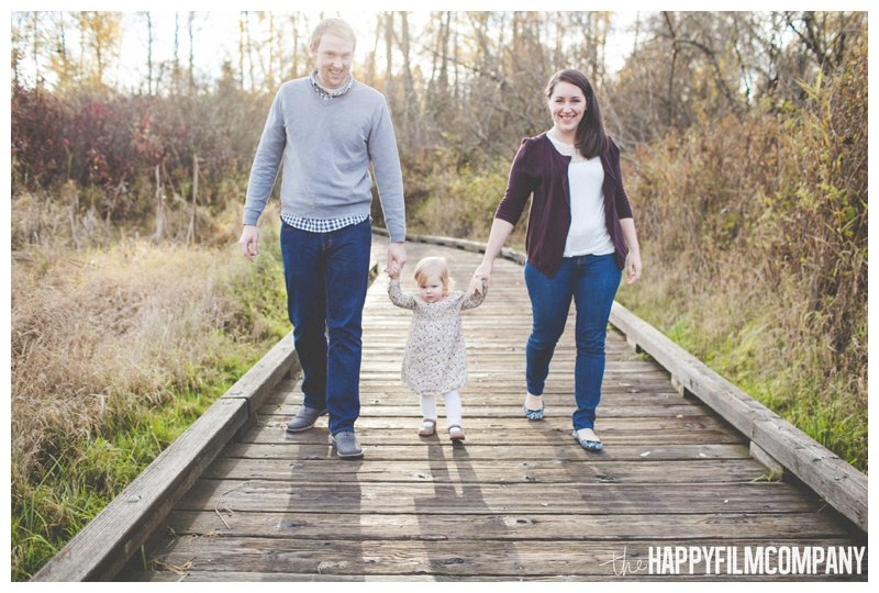 family holding hands walking on boardwalk - the Happy Film Company - Seattle Family Photography