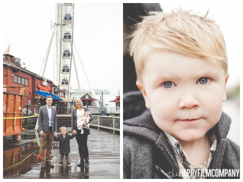 family standing on dock in rain  - Seattle Waterfront Family Holiday Photos - the Happy Film Company