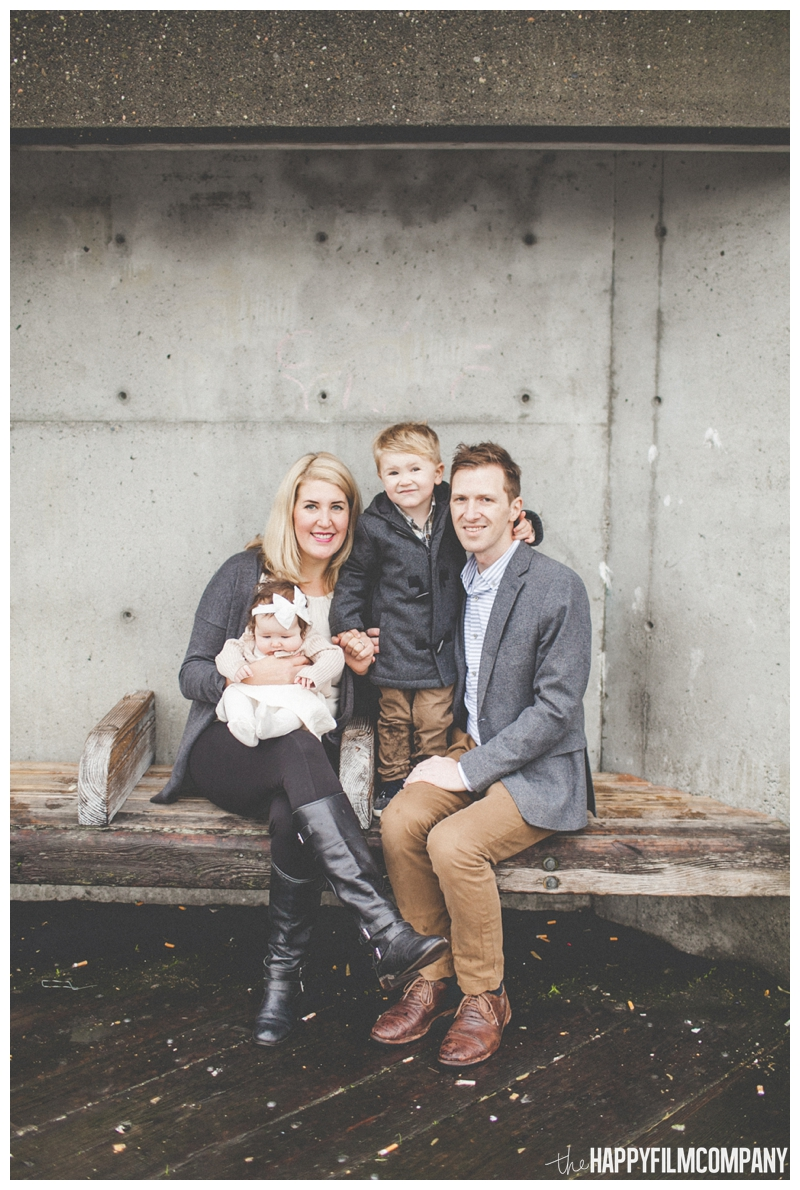 concrete cement background for family pictures  - Seattle Waterfront Family Holiday Photos - the Happy Film Company