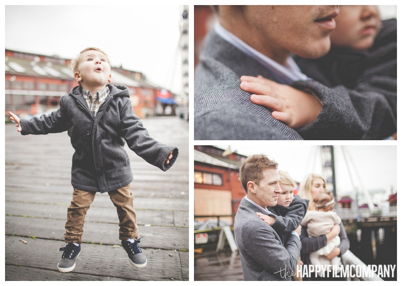 little boy jumping in rain  - Seattle Waterfront Family Holiday Photos - the Happy Film Company