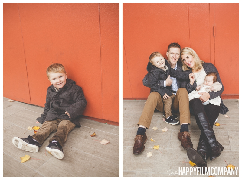 family photos with bright red wall background  - Seattle Waterfront Family Holiday Photos - the Happy Film Company