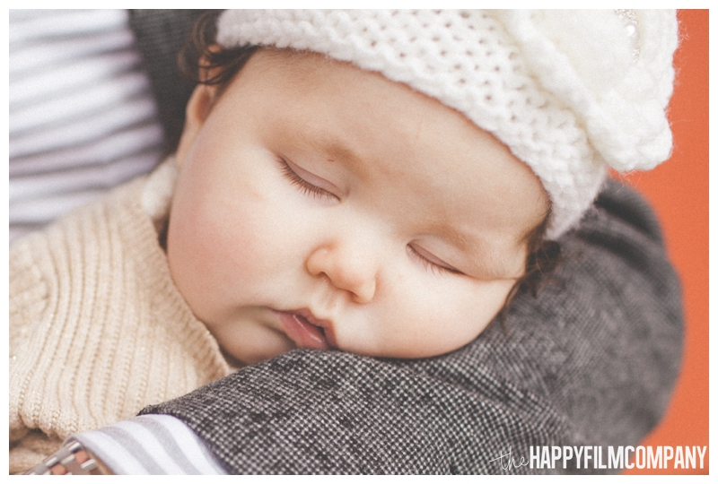 cute little baby face asleep  - Seattle Waterfront Family Holiday Photos - the Happy Film Company