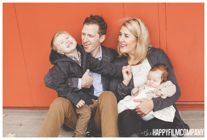 family photos with red background for holiday pictures  - Seattle Waterfront Family Holiday Photos - the Happy Film Company