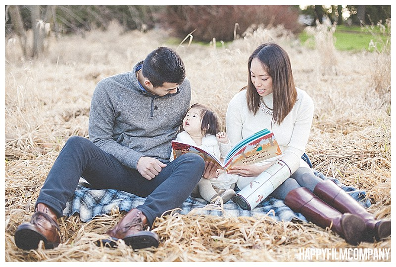 family reading on blanket  - the Happy Film Company - Winter Family Portraits Seattle