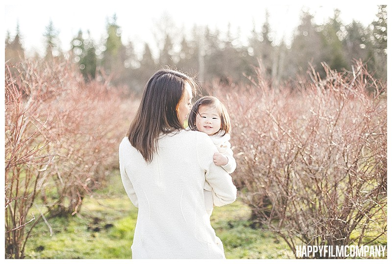 mother daughter photo in blueberry farm  - the Happy Film Company - Winter Family Portraits Seattle