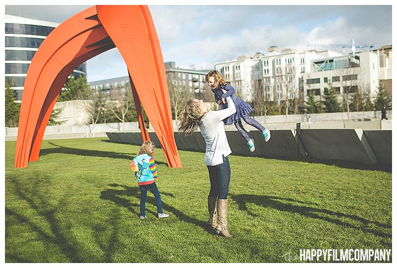 throwing kid in air city portraits  - the Happy Film Company - Seattle Olympic Sculpture Garden Family Photos Seattle