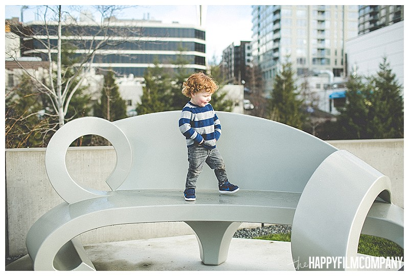 little boy walking on bench  - the Happy Film Company - Seattle Olympic Sculpture Garden Family Photos Seattle