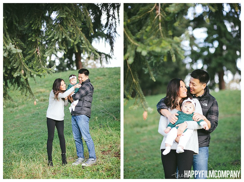 family hugging underneath tree  - the Happy Film Company - Winter Seattle Family Portraits