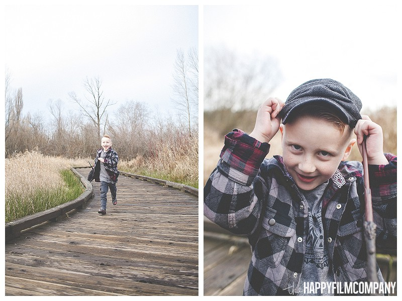 little boy running on boardwalk adjusting hat  - Playful Seattle Family Photos - the Happy Film Company