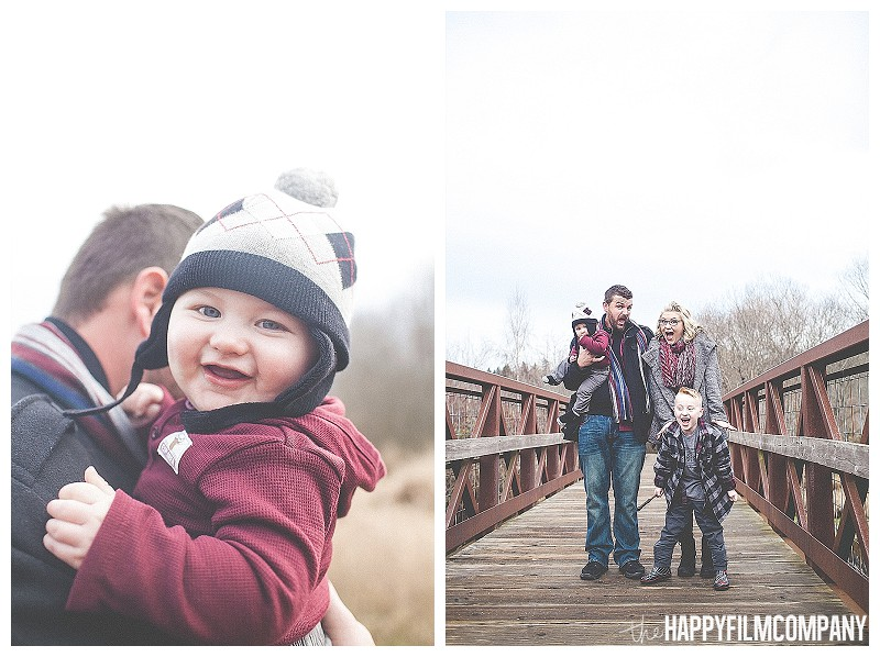 father son picture  - Playful Seattle Family Photos - the Happy Film Company family standing onn bridge