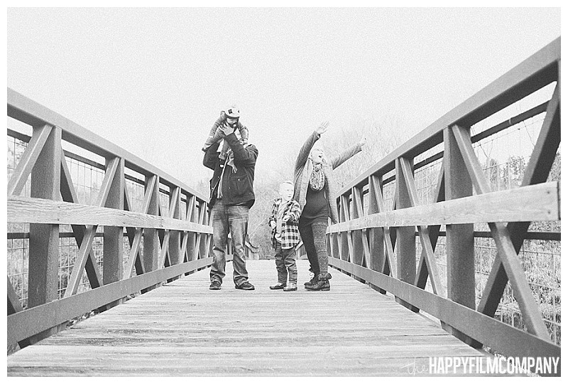 black and white portrait on bridge mercer slough nature park  - Playful Seattle Family Photos - the Happy Film Company